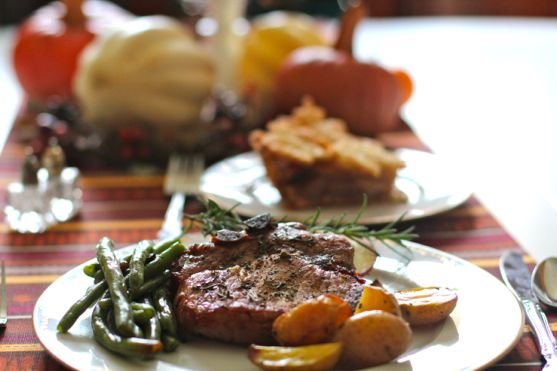 Baked Pork Chops with Rosemary, Apples and Caramelized Onions by Angela Roberts