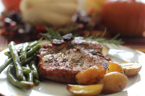 Pork Chops with rosemary apples and caramelized onions by Angela Roberts