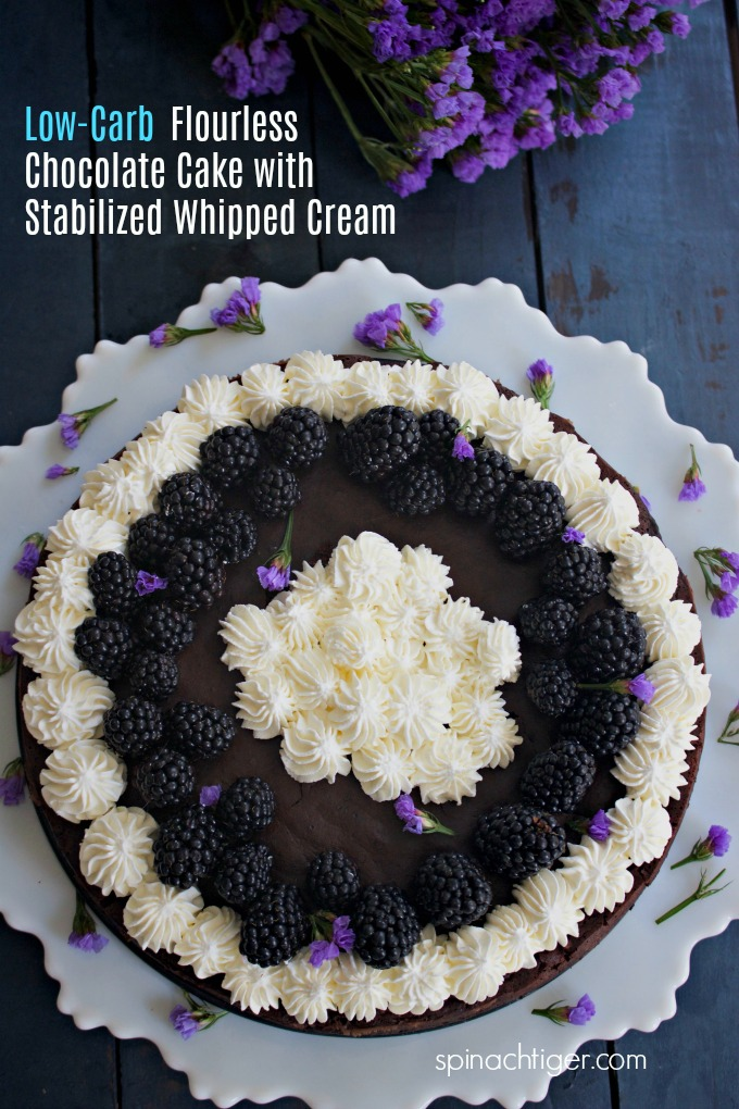 Low Carb Flourless Chocolate Cake with Stabilized Whipped Cream will make any day feel special. This is our go to dessert for almost every occasion. #spinachtiger via @angelaroberts