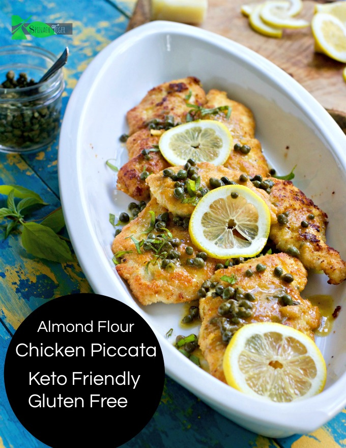 Almond Floured Chicken Piccata with Lemon and Capers. Keto, Paleo and Gluten Free, this grain free Italian Chicken will be a go to. #ketochicken #chickenpiccata #spinachtiger #almondflour via @angelaroberts