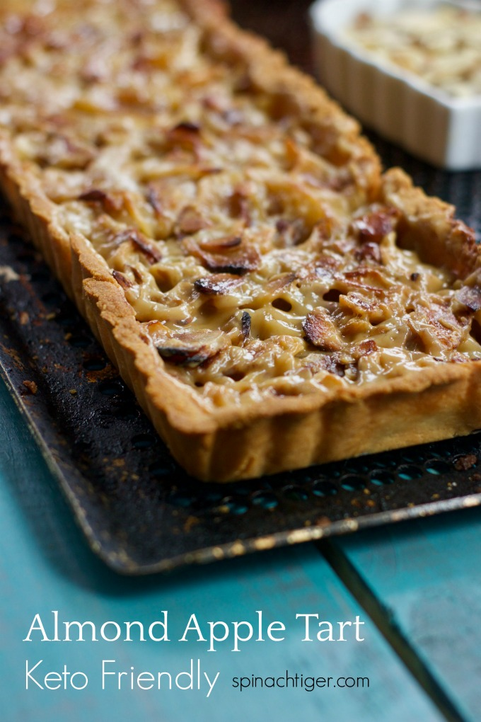 Grain Free Paleo Friendly Apple Almond Tart. Almond flour crust, apples, Swerve, almonds, heavy cream make this elegant and delicious tart at 3 net carbs per serving. #applealmondtart #lowcarb #spinachtiger via @angelaroberts