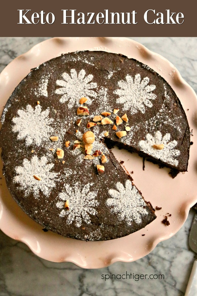 Make this grain free, keto friendly hazelnut torta caprese cake and make any holiday special. Made with hazelnut flour, a bit of coconut flour, butter and good chocolate. Tastes like nutella. #grainfreecake #hazelnutflour #chocolate #italiancake. #spinachtiger. via @angelaroberts