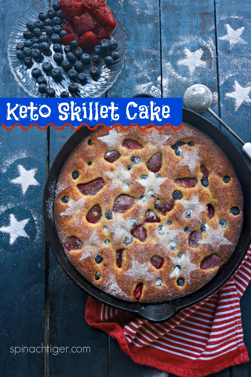 Easy keto mixed berry cake made with almond flour, summer berries, doused with Swerve Confectioner's sugar from #spinachtiger #ketosnackcake #ketoskilletcake #blueberries #strawberries via @angelaroberts