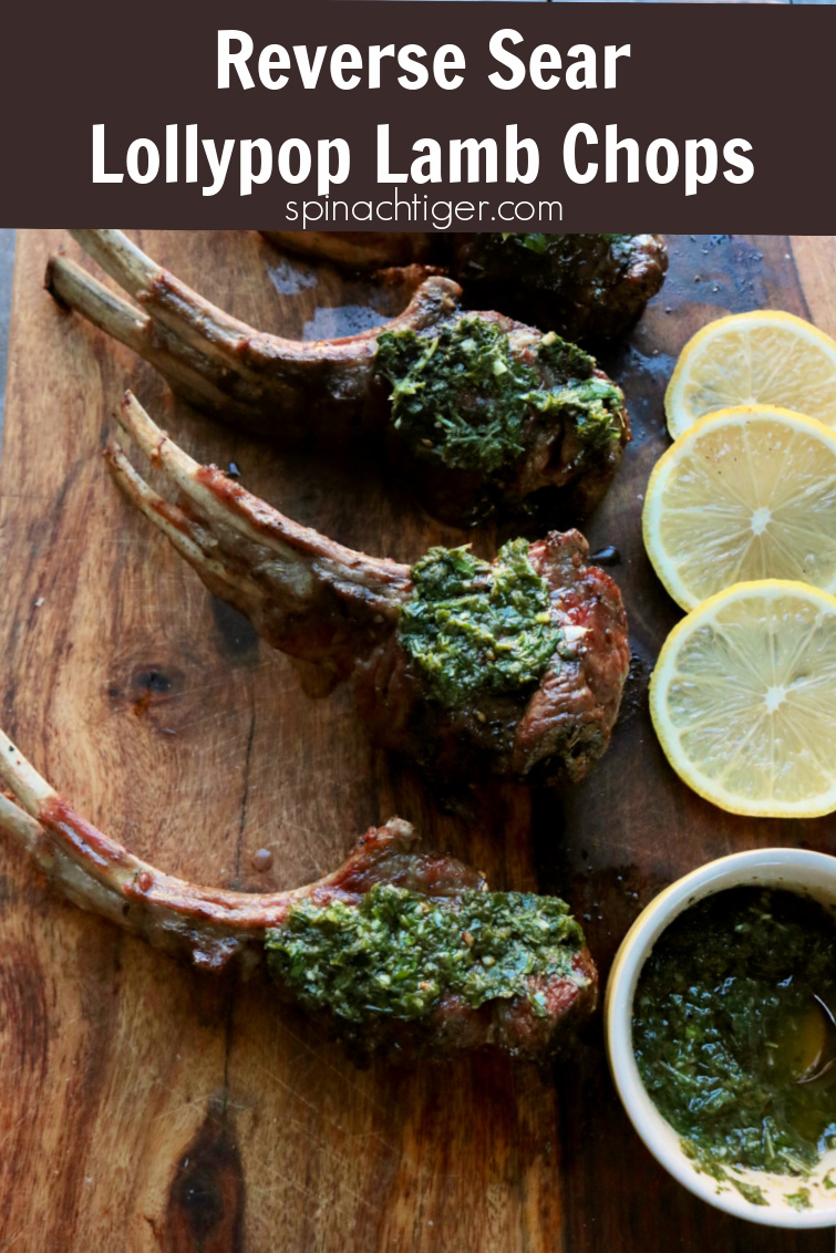 Grilled Lollypop Lamb Chops using a reverse sear with a mint pistou. These are the best lamb chops I have ever eaten. Reverse sear is easy and results in the best texture. Learn how to trim a rack of lamb and make perfect #lollypoplambchops. #lambchops #mint #lamb #grilledlamb #pistou #spinachtiger via @angelaroberts