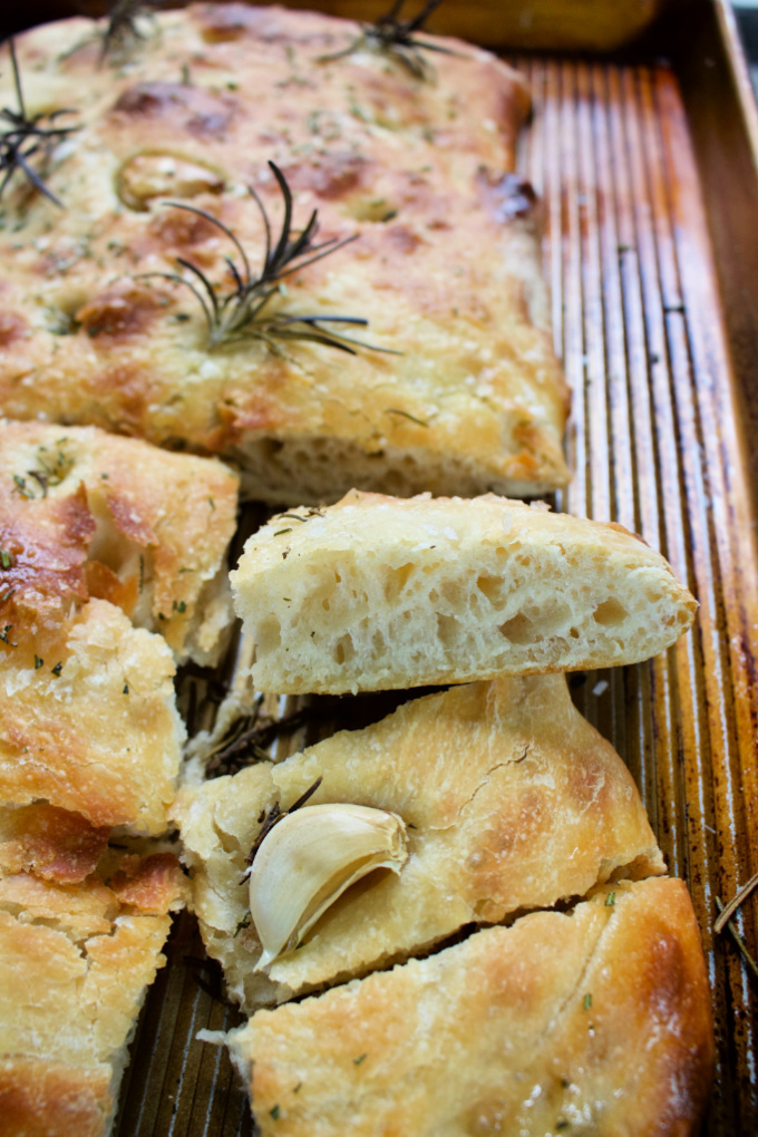 Easy to Make Sourdough Focaccia with fresh garlic, rosemary and flaked sea salt. Using Emilie Raffa's recipe, it's approachable and perfect. #spinachtiger #sourdoughrecipe #sourdoughfocaccia #focaccia via @angelaroberts